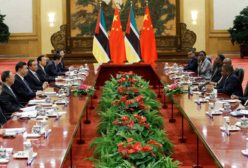 Chinese President Xi Jinping and Mozambican President Filipe Nyusi attend a meeting at the Great Hall of the People in Beijing