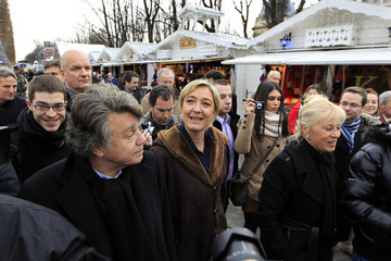 Marine Le Pen, France's National Front head and candidate for the 2012 French president election, and lawyer Collard visit a Christmas market in Paris
