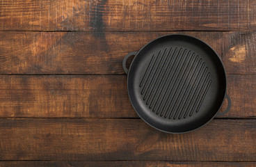 Vintage empty grill pan on rustic wooden table