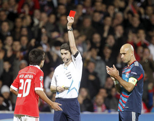 Referee Mallenco shows the red card to Gaitan of Benfica during their Champions League soccer match against Olympique Lyon at the Gerland stadium in Lyon
