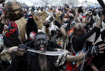 Local residents dressed in costumes perform during celebrations for the Malanka holiday in the village of Krasnoilsk in the Chernivtsi region of Ukraine