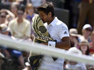 Fernando Verdasco of Spain wipes his face during his match against Stan Wawrinka of Switzerland at the Wimbledon Tennis Championships in London