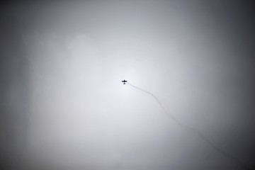 An aircraft performs during the International Air and Space Fair at Santiago