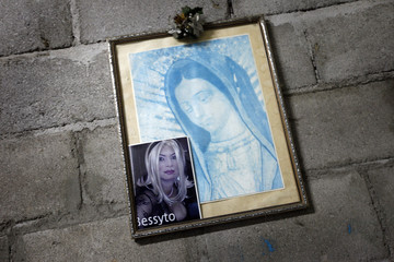 A picture of transgender Bessy is seen on a framed portrait of the Virgin Mary in Tegucigalpa