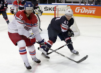 Cervenka of the Czech Republic is challenged by Krug of the U.S. during their Ice Hockey World Championship third-place game at the O2 arena in Prague