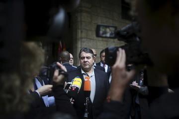 Germany's Economy Minister Sigmar Gabriel talks to journalists in Old Havana