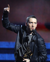 """Eminem accepts his award for Best Rap Solo Performance for """"Not Afraid"""" at the 53rd annual Grammy Awards in Los Angeles"""