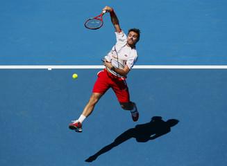 Stanislas Wawrinka of Switzerland hits a return to Andrey Golubev of Kazakhsta during their men's singles match at the Australian Open 2014 tennis tournament in Melbourne