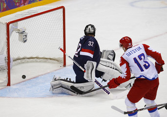 Russia's Datsyuk scores on Team USA's goalie Quick during the second period of their men's preliminary round hockey game at the 2014 Sochi Winter Olympic Games