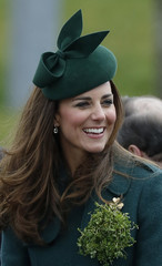 Britain's Catherine, Duchess of Cambridge wears a sprig of shamrock during a visit with her husband Prince William to the 1st Battalion Irish Guards for a St Patrick's Day Parade at Mons Barracks in Aldershot