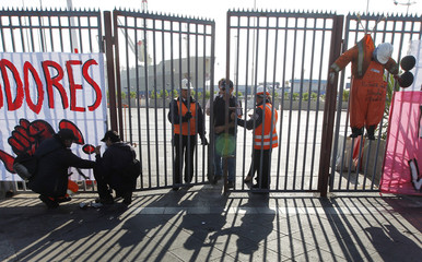 Guards control access to the port during a strike by dock workers against the government in Valparaiso city