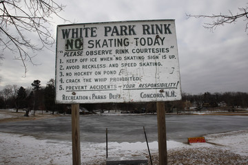 "A sign for White Park Rink reads ""No Skating Today"" at White's Pond in Concord, New Hampshire"