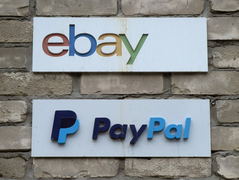 Signs hang outside the offices of online marketplace eBay and its electronic payments division PayPal in Toronto