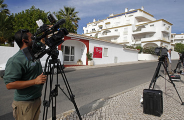 A camerman takes video footages outside the Ocean Club holiday resort in Praia da Luz