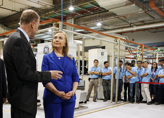 U.S. Secretary of State Hillary Clinton tours a General Electric Aviation facility in Singapore