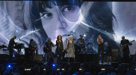 Image of singer Ronstadt is seen in background as musicians Raitt, Harris and Underwood perform after Ronstadt was inducted at 29th annual Rock and Roll Hall of Fame Induction Ceremony in Brooklyn, New York