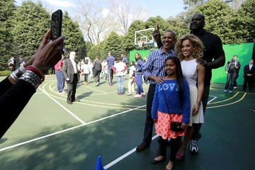 Obama poses for a picture with O'Neal and Alexander on the basketball court at the annual Easter Egg Roll at the White House in Washington