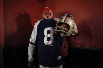 A man dressed up as zombie poses for a picture during an event in New York