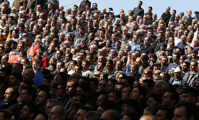 Supporters of Turkish Prime Minister Erdogan listen to his speech during the opening ceremony of a new line of the Ankara Metro in Ankara