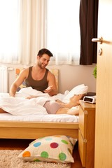 Young couple in bed in the morning