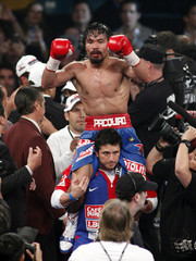 Pacquiao of the Philippines celebrates his majority decision victory over Marquez of Mexico for the WBO welterweight title