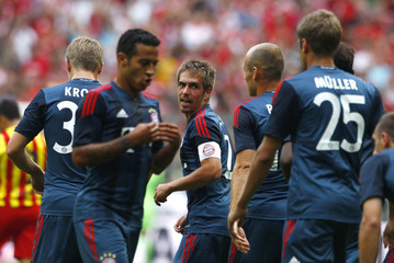 Bayern Munich's Philipp Lahm celebrates with team mates after scoring a goal during their Uli Hoeness Cup friendly soccer match against Barcelona in Munich