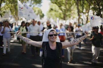 A teacher attends a demonstration against government austerity measures in Lisbon