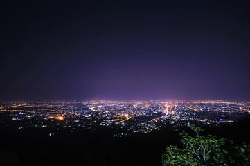 city at night in dark sky