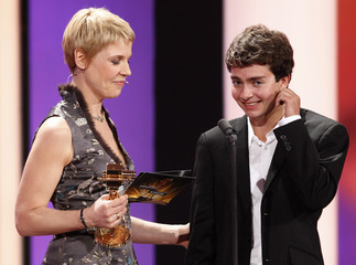 Max Hegewald receives the award for best newcomer from comedian Cordula Stratmann during Golden Camera awards in Berlin