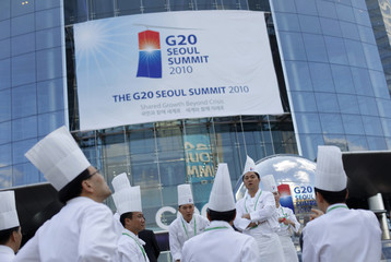 Catering staff pose for pictures outside the COEX Centre