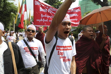 Protesters shout during a march to denounce foreign criticism of the country's treatment of stateless Rohingya Muslims, in Yangon