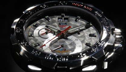 """A Tag Heuer logo is seen on the """"Grande Date"""" watch displayed on the watchmaker's showcase at the Baselworld"""