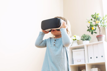 Toddler girl using a virtual reality headset