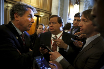 Brown speaks with reporters after the weekly party caucus luncheons at the U.S. Capitol in Washington