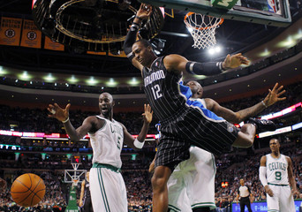 Magic center Howard dunks the ball against the Celtics in the first quarter of their NBA Basketball game in Boston