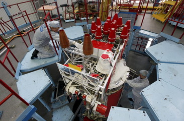 Fitters of space apparatus work on GLONASS-M space navigation satellite inside assembly workshop of Reshetnev Information Satellite Systems company in Zheleznogorsk