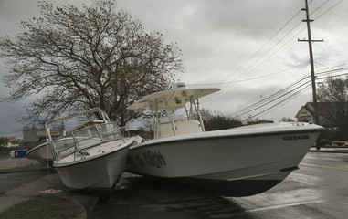 Power  boats sit in Broadway Avenue after washing away from moorings during Hurricane Sandy in Point Pleasant Beach, New Jersey