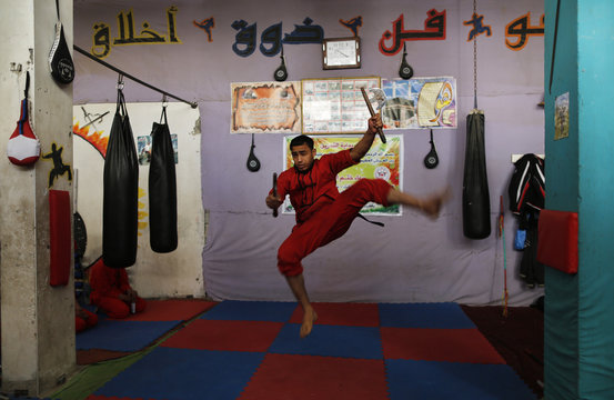 Palestinian boy practices during class at the Red Dragon martial arts club in Beit Lahiya