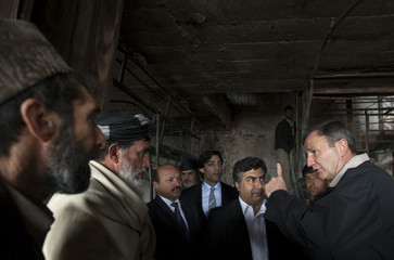 U.S. Ambassador to Afghanistan Karl Eikenberry speaks with the shop owners in Kabul