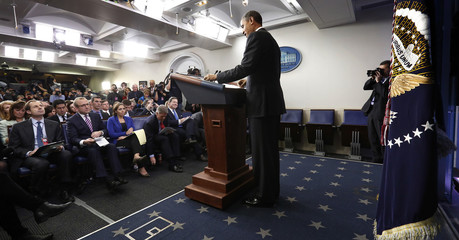 U.S. President Obama addresses reporters during his year-end news conference in the White House Briefing Room in Washington