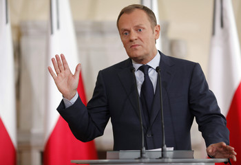 Poland's Prime Minister Tusk gestures during a news conference about the death of Poland's late president in a plane crash, at the Prime Minister Chancellary in Warsaw