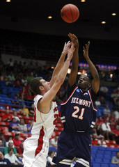 Belmont Bruins guard Ian Clark shoots over Wisconsin Badgers guard/forward Tim Jarmusz during the second round NCAA game in Tucson