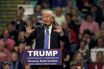 U.S. Republican presidential candidate Donald Trump speaks to supporters at the Florence Civic Center in Florence