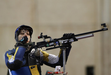 A shooter takes part in an air rifle training session ahead of the ISSF Shooting World Cup at the Olympic shooting venue in London