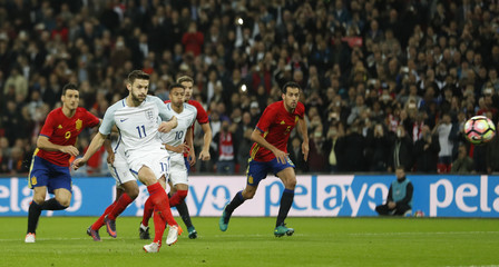 England's Adam Lallana scores their first goal from the penalty spot
