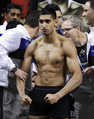WBA super lightweight champion Khan of Britain poses for fans during an official weigh-in in Las Vegas