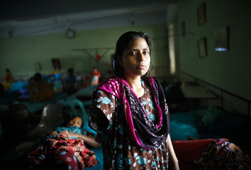 A worker rescued from the rubble of the collapsed Rana Plaza building, stands inside the Centre for Rehabilitation of Paralysis in Savar