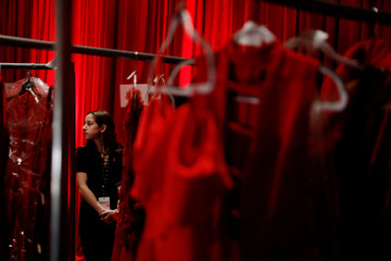 A woman stands backstage before the American Heart Association's Go Red For Women Red Dress Fall/Winter show during New York Fashion Week in the Manhattan borough of New York