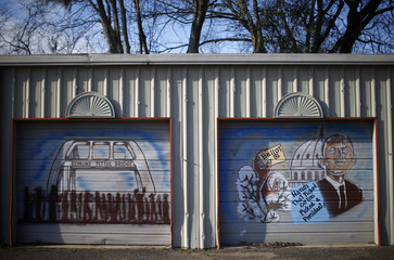 Painted murals on garage doors in Selma