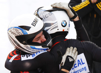 Germany's pilot Friedrich and brakeman Baecker celebrate after winning the 2-men competition at the FIBT Bobsleigh and Skeleton World Championships 2013 in the Swiss mountain resort of St. Moritz